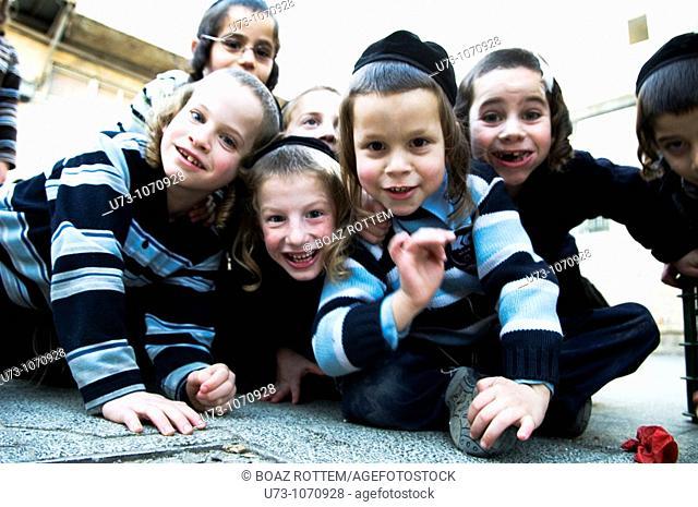 cute Jewish orthodox boys having fun with the camera in their Yeshiva / school in the religious neighborhood of Mea Shearim in Jerusalem
