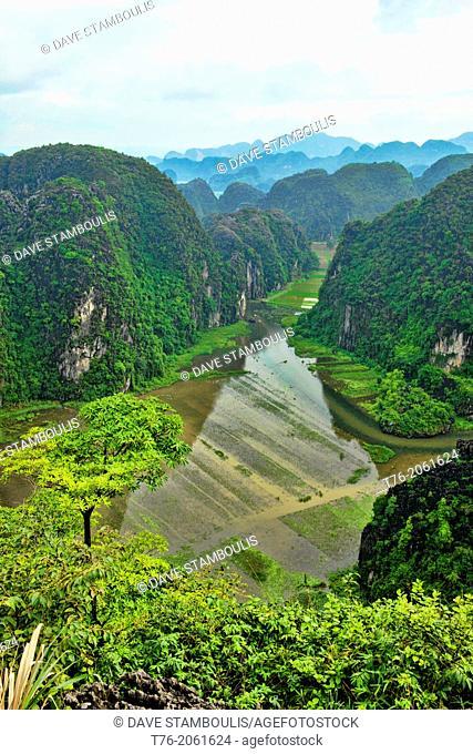 beautiful limestone karst mountains over the Tam Coc River in Ninh Binh, Vietnam