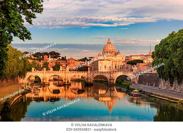 Saint Peter Cathedral and Saint Angel bridge over the Tiber River in the morning in Rome, Italy