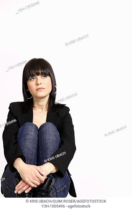 Studio shot of young Italian woman, thoughtful