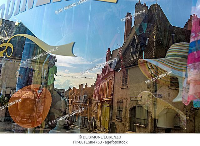 Europe, France, La Charitè-sur-Loire, Nievre, Loire Valley, shop window reflections