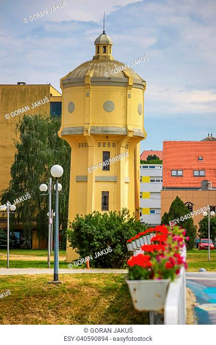 Old water tower with lined up flower on the pedestrian bridge in the Vukovar, Croatia