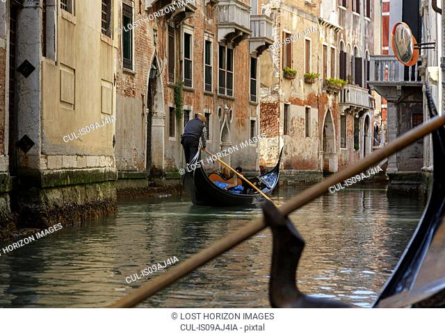 Gondolas on canal waterway, Venice, Veneto, Italy