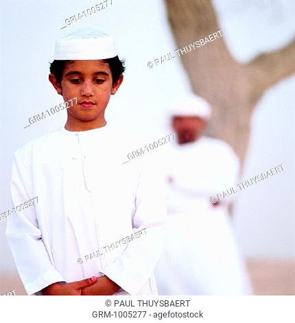 Arab father and son in the desert