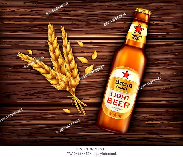 Brand labeled brown glass bottle with light beer on wooden background with ingredient, barley ears, realistic. Poster template for classic craft beer