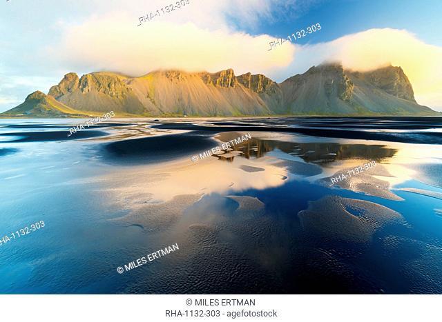 Mount Vestrahorn shrouded in clouds at sunrise, Stokksnes, Iceland, Polar Regions