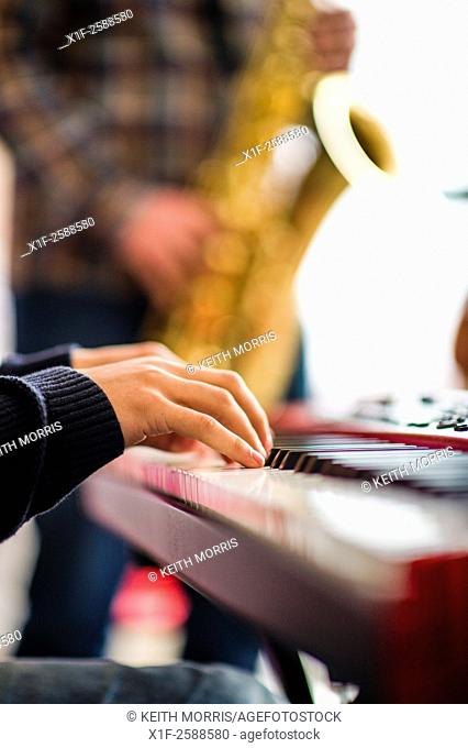Jazz music : a musican playing a piano in a group