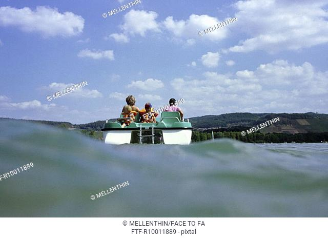 Family on a pedal boat