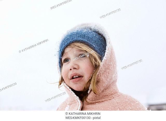 Portrait of little girl in snowfall