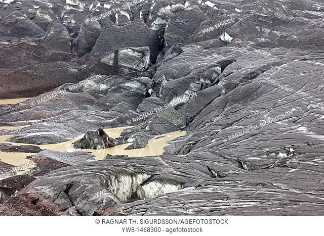 Ash fall on Svinafellsjokull from Grimsvotn volcanic eruption, Iceland  The landscape filled with ash, eruption began on May 21, 2011