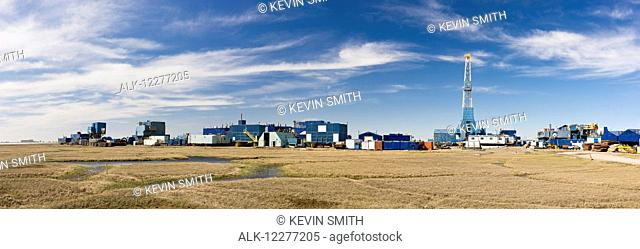 Oil and gas drill rig with surrounding infrastructure, Prudhoe Bay, Arctic Alaska, USA, Summer