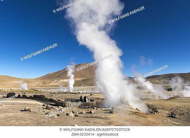 Steam rising from hot springs at El Tatio Geysers geothermic basin near San Pedro de Atacama in the Atacama Desert, northern Chile