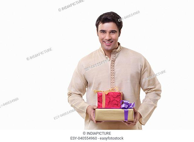 Portrait of a Bengali man holding gifts