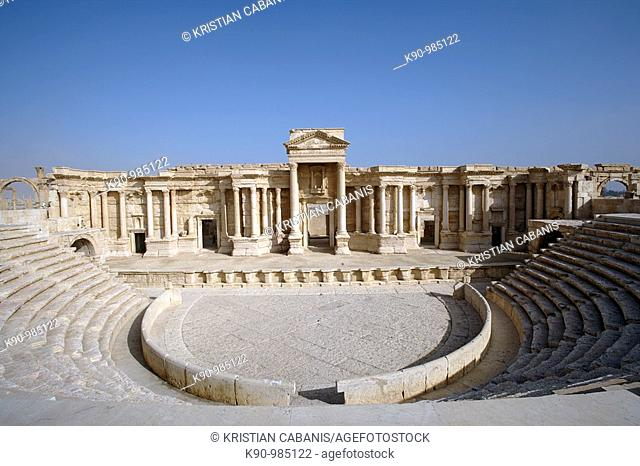 Theater at the archeological and UNESCO world heritage site of the greco-roman ruins of the city of Palmyra at blue sky, Tadmur, Syria, Near East, Asia