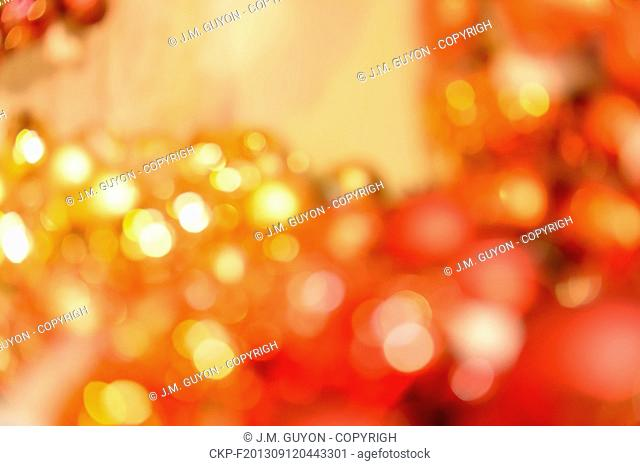 Blurred red and gold Christmas balls background
