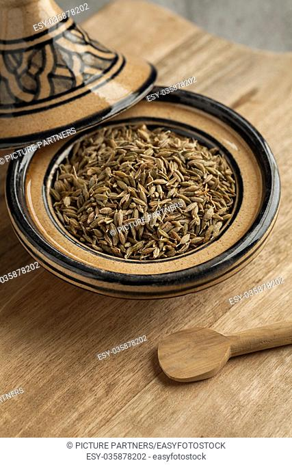 Moroccan tajine with dried cumin seeds