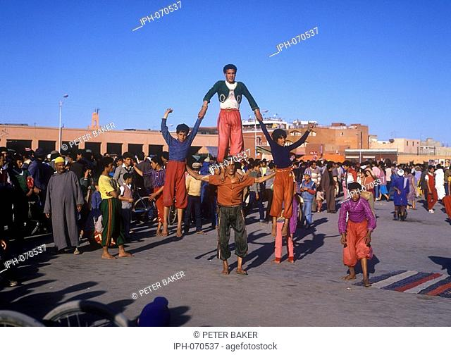 Street performers entertaining the crowds in Djemaa el Fna, the huge square in the Moroccan city of Marrakesh