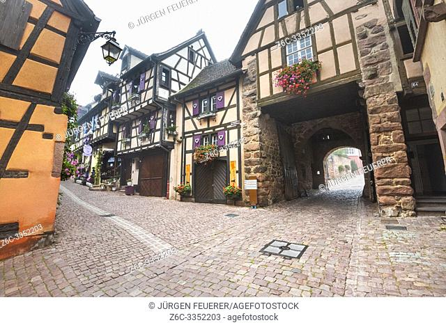 old half-timbered houses in Riquewihr with town gate, Alsace Wine Route, France, touristy medieval site