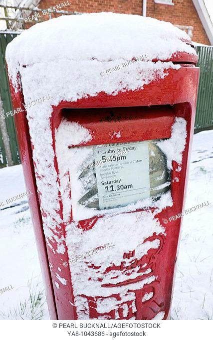 Britain, UK, Europe  Red postbox covered in snow