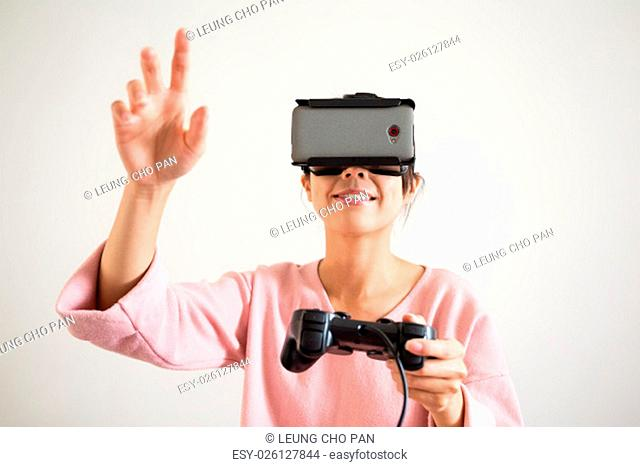 Young Woman play game with vr device and hand want to touch something