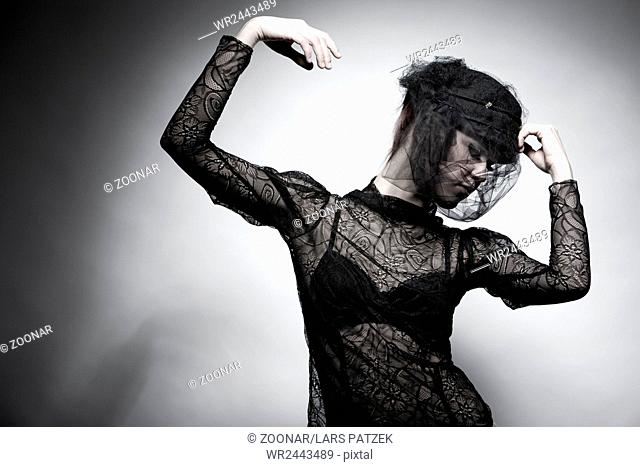 Young woman wearing haute couture lace top