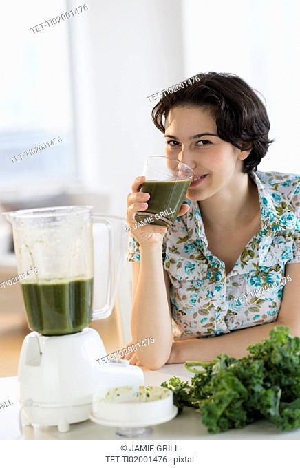 Woman drinking kale juice