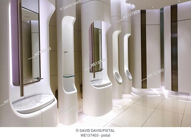 Contemporary mens public restroom in an upscale shopping centre