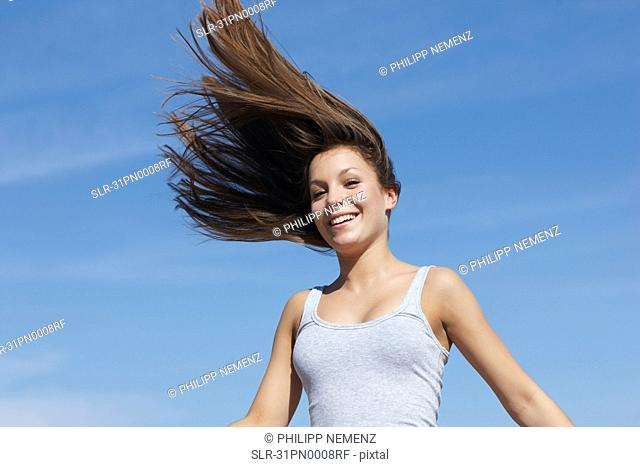 Woman with flying hair smiling