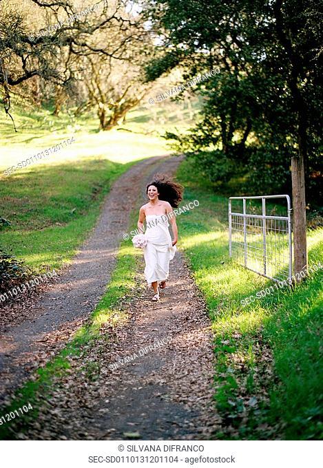 Smiling bride running