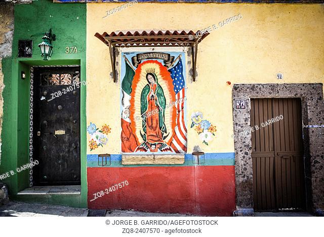 Virgen de Guadalupe with american an mexican flags