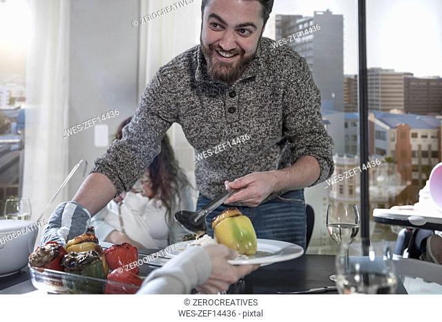 Smiling man serving food