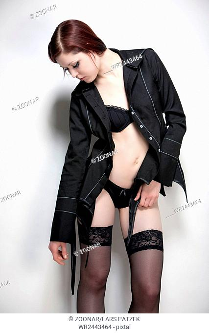 Young woman in underwear and designer jacket