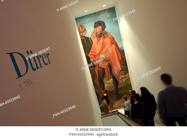Journalists walk down to the exhibition past a picture of Albrecht Duerer at the Staedel Museum in Frankfurt Main, Germany, 22 October 2013