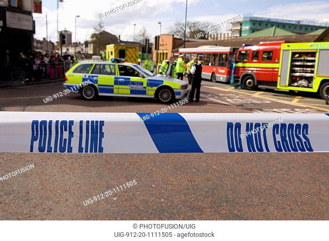 Police officer and cordon sign at the scene at a road traffic accident, Hounslow, Middlesex 30th March 2008
