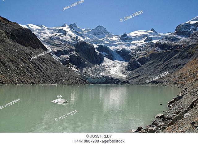 Die Gipfel Piz Sella, I Gemelli, La Sella, Piz Glüschaint, La Muongia, von links nach rechts, der Sella-Gruppe über dem Gletschersee Lej da Vadret in der Val...