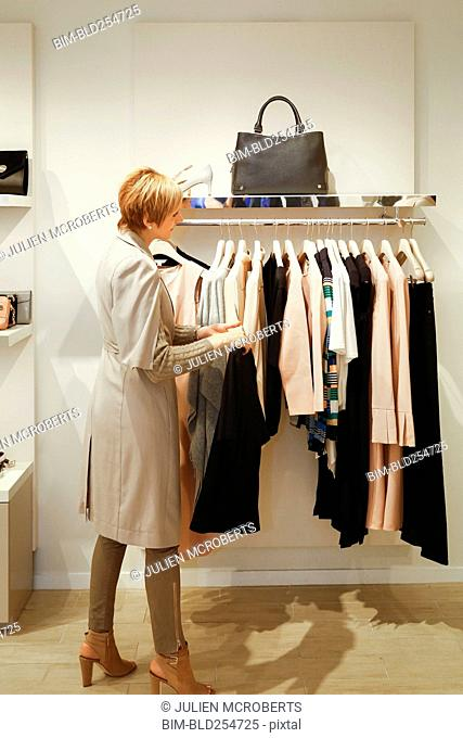 Caucasian woman shopping for clothing