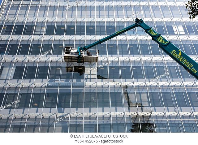 window cleaners working from elevator truck basket