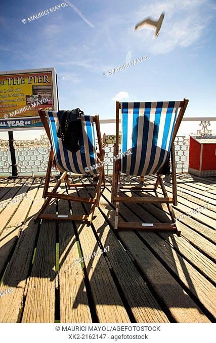 Couple suntanning in hammock, Brighton, UK
