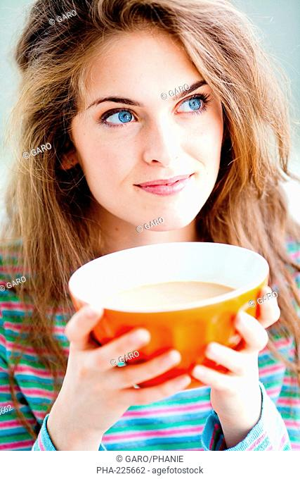 Woman drinking coffee with milk
