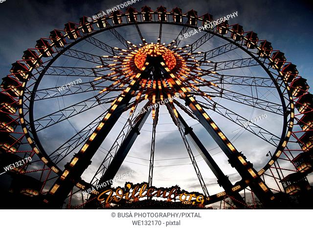 Spectacular Ferris Wheel at the Christmas Market at Rotes Rathaus in Berlin (Berliner Weihnachtszeit am Roten Rathaus) at twilight