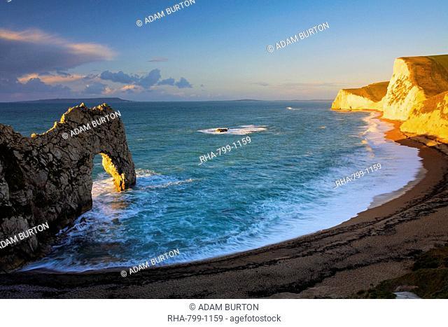 Early morning sunshine glows golden on the clifftops near Durdle Door, Jurassic Coast, UNESCO World Heritage Site, Dorset, England, United Kingdom, Europe