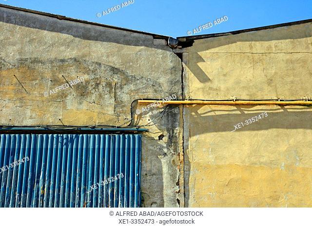 cables and metallic door, industrial polygon, plaza del Nou, Zona Franca, Barcelona, Catalonia, Spain