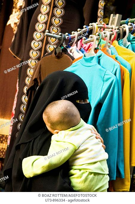 An Arab woman with her baby