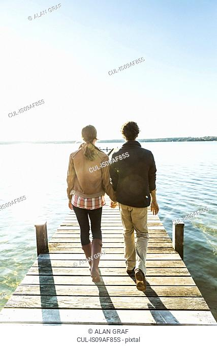 Couple on jetty, Lake Starnberg, Bavaria, Germany