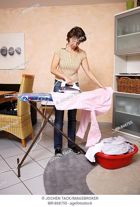 Housewife ironing washing