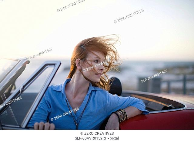 Woman sitting in her car