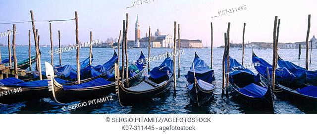 Gondolas at San Marco Pier and San Giorgio Maggiore in background. Venice. Veneto, Italy