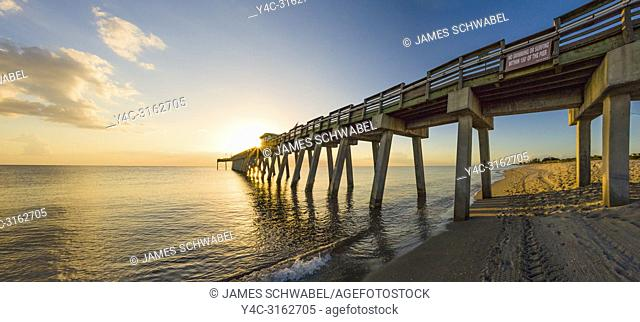 Fishing pier on Gulf of Mexico at sunset in Venice Florida