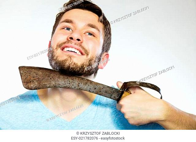 Man shaving with very large knife