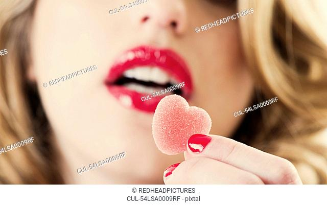Close up of woman holding gummy candy